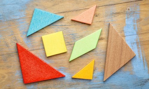 Pieces of wooden tangram puzzle